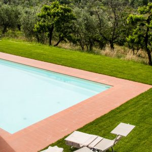 Relais Villa Olmo hotel chianti offers swimming pool and green areas perfect to immerse guests in peace and tranquillity of tuscan countryside