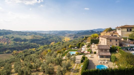 tuscan hills and ancient borgo Relais Villa Olmo resort with pool Tuscany