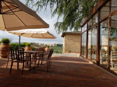 external terrace surrounded by tuscan countryside at Relais Villa Olmo food resort tuscany