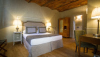 deluxe room of our food resort with pool near florence